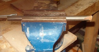 woodturning tool shaft in vise ready for grinding